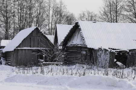inclement: the old wooden buildings covered with snow