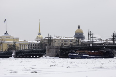 outpost: ST. PETERSBURG, RUSSIA - JAN 24, 2016: Ice-class tugboat Nevskaya Zastava (Neva Outpost) on Neva river. In spite of icebreaker functions it can put out fires and take part in rescue operations. Editorial