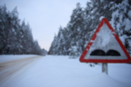 sweeps: Snowy road through the forest, day. The road is covered with snow. Winter forest, snowy forest. Stock Photo