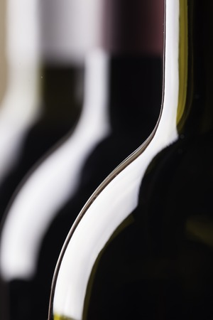 corked: silhouettes of the bottles close up on black buckground