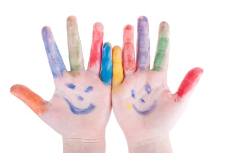 childrens hands closeup painted colors  isolated on white background