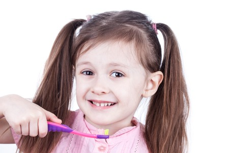 dientes con caries: Smiling child decayed teeth with toothbrush on white background