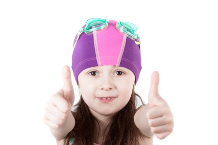 swimming cap: child girl in pool swimming cap isolated on white background. gesture of OK Stock Photo