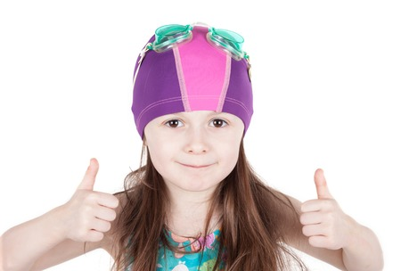 swimming cap: portrait of happy child girl in pool swimming cap isolated on white background. gesture of OK