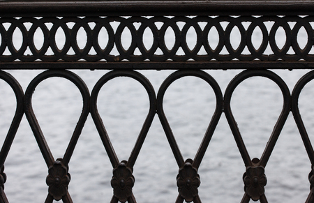 grille: the cast-iron railing of the bridge close up