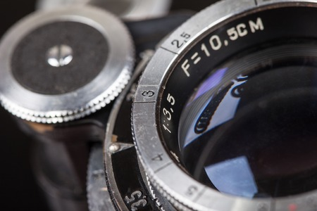 classical mechanics: Lens of retro camera looking up macro close up