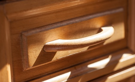 drawer: front of handle pull-out furniture drawer closeup