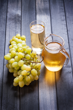 grape juice: Grape juice in the glass and pitcher vertical still life Stock Photo