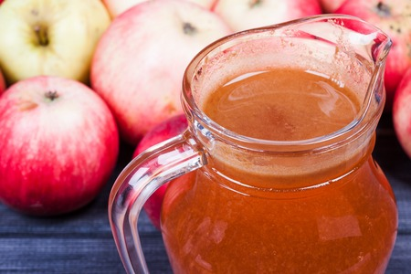 fresh apple juice in the pitcher table close up Imagens