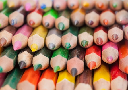 many colored pencils macro close up background