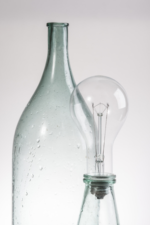 abstract still life clear glass vintage bottle and lamp Imagens