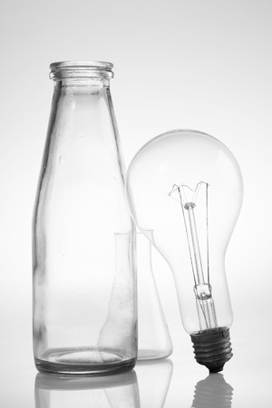 abstract still life with clear glass vintage bottles and electric lamp
