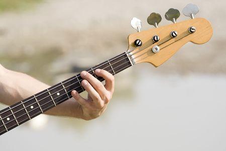 distortion: neck of bass guitar Stock Photo