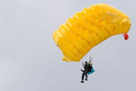parachutist with sky over him