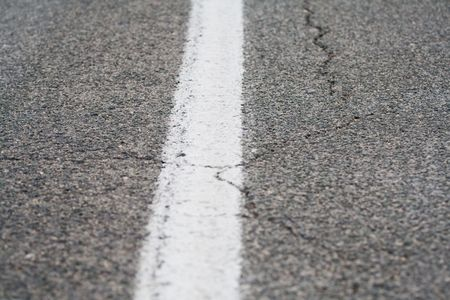 close up of roadway tarmac or asphalt texture with full white line Stock Photo - 4848457