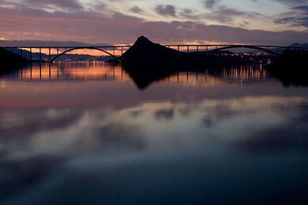 romantic sunset over sea water photo
