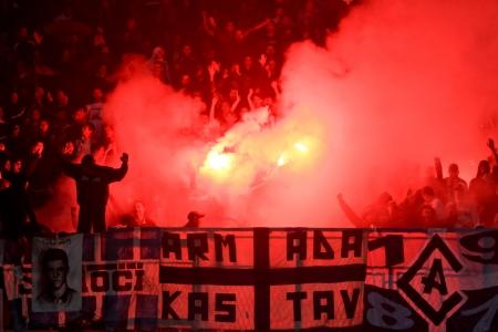 RIJEKA, CROATIA - SEPTEMBER 01: soccer match between HNK Rijeka (white) and HNK Hajduk (red-blue) ; soccer fans celebrating at the stadium on September 01, 2012 in Rijeka, Croatia