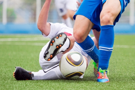 tackles: soccer or football Stock Photo
