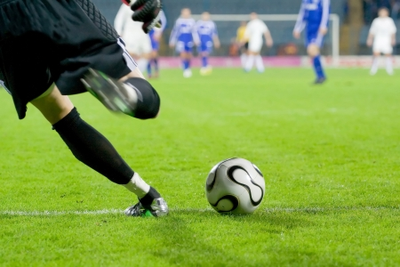 soccer ball on grass: soccer or football goalkeeper kick the ball Stock Photo