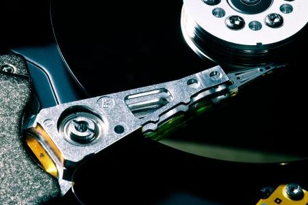 disco duro: Close up de disco duro con la reflexión negro