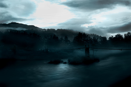 Horror scene of a old rustic bridge over river photo