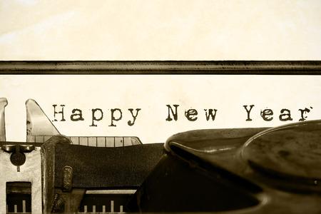 Inscription Happy New Year written on an old typewriter Stock Photo