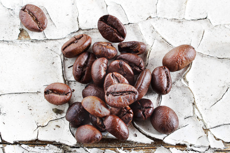 Coffee beans on rustic white background photo