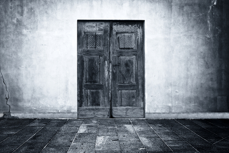 horror: Wide grunge vintage background with old door, empty room interior as backdrop Stock Photo