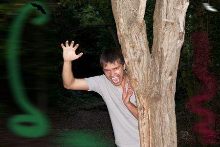 merciless: Fellow vampire looks from the tree night in the dark terrified