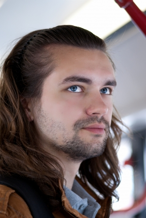 Young sexy attractive guy with long hair