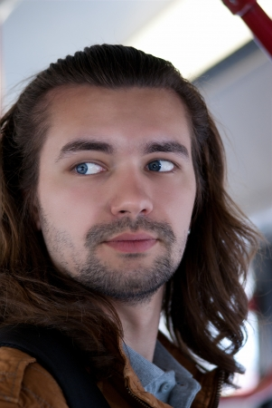 Young sexy attractive guy with long hair  photo