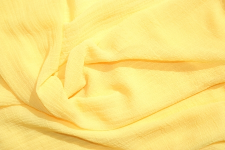 yellow silk scarf is decorated and fascinates Banco de Imagens