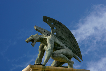 guardian gargoyle over Pont del Regne of bridge of the kingdom  Valencia  Spain photo