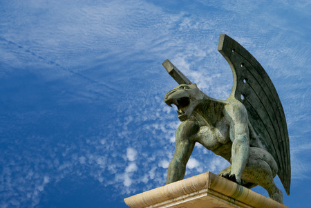 guardian gargoyle over Pont del Regne of bridge of the kingdom. Valencia. Spain photo