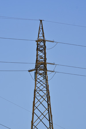 High-voltage tower  Electric powerlines on the blue sky  Stock Photo
