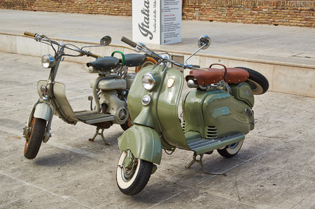 Old Vintage green motorcycle on the streets of Italy, Sinegalia, Ancona photo