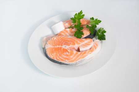 Fresh trout on the white plate, served with parsley photo