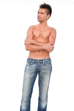 Young sexy guy in jeans with bare torso