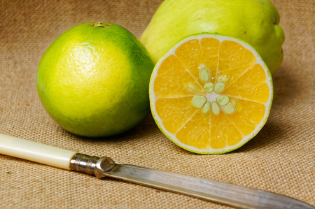 laxative: The lime fruit close-up on wooden table. Full of vitamins and minerals.