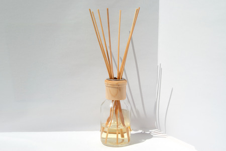 pleasant emotions: composition of fragrances for the home. Bottle of natural fragrances with bamboo sticks