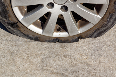 tearing down: Fully broken wheel after puncture. Automobile accident with replacement wheels.