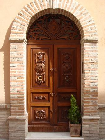 architectural details: Brown varnish wooden door in an old Italian house. Architectural details.