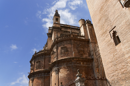 Historic buildings and monuments of Seville, Spain. Architectural details, stone facade and museums. Catedral de Santa Maria de la Sede. Giralda tower
