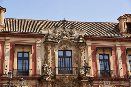 Historic buildings and monuments of Seville, Spain. Architectural details, stone facade and museums. Palacio Arzobispal Editorial