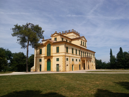 Italian country house in the ancient tradition among green field and beautiful trees. Italian Villa for rest at the week end.