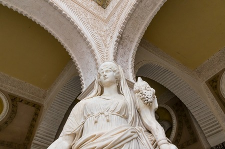 Historic buildings and monuments of Seville, Spain. Architectural details, stone facade and museums Europe. Spanish architectural styles of Gothic. Statue. marble head and bas-relief Editorial