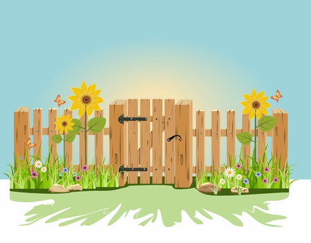 A wooden gate and fence with green grass and flowers