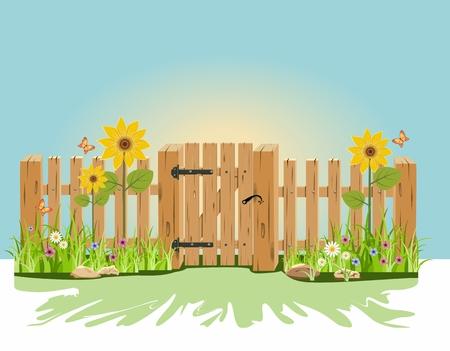 Une porte en bois et de clôture avec de l'herbe verte et des fleurs Banque d'images - 40572650