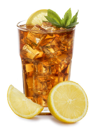 The glass of ice tea garnished with lemon and mint, isolated on white background.