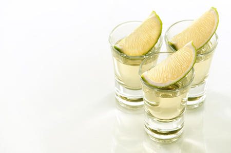 toned image: Toned image. A tequila shots with a slice of lime